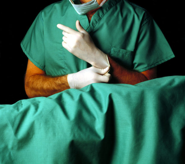 surgeon putting on gloves, how to avoid colonoscopy exam
