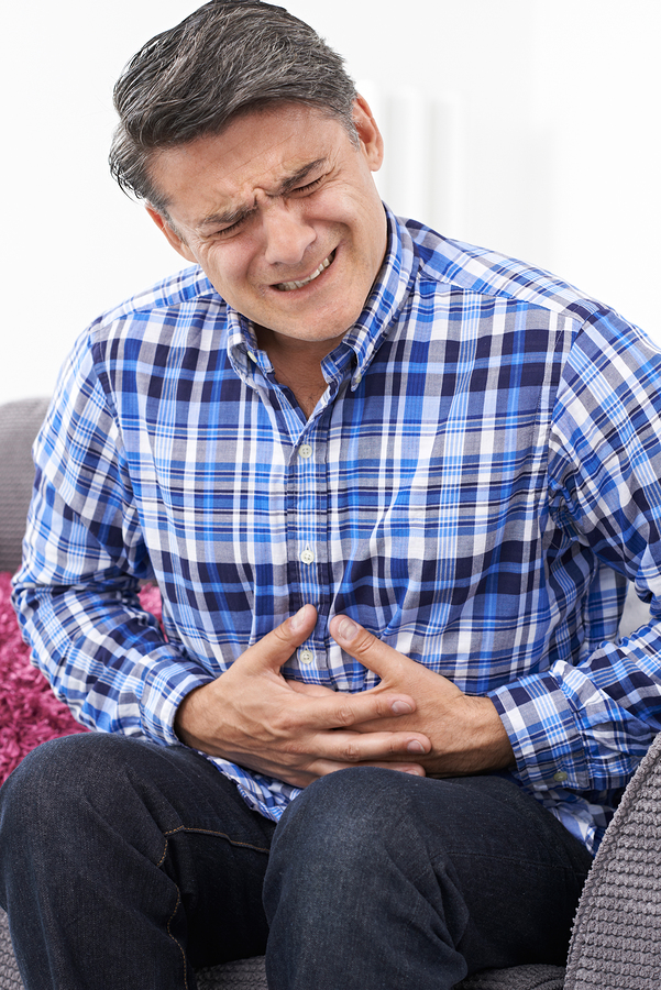 man in pain from indigestion, which fiber helps overall health, best kinds of fiber, can fiber help or hurt your health?