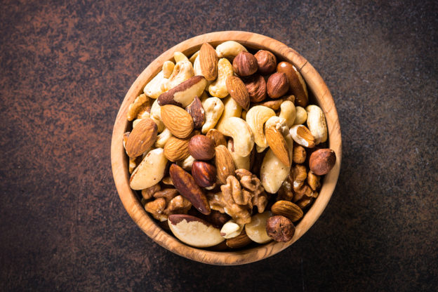 which nuts are healthiest, is it okay to eat nuts, will nuts make me gain weight, do nuts protect your heart, health benefits of nuts, is eating peanuts safe, nuts and gut microbiota, is it ok for diabetics to eat nuts, will nuts make me fat